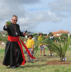 Cardinal John Dew blesses new building site for Our Lady of Kapiti parish and school as St Patrick's school children watch. Photo: Kapiti Observer