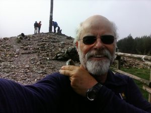 Joe Green at the Cruz Ferro where pilgrims leave a rock from home.