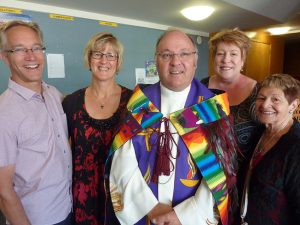 Fr Bill Warwick and parishioners from his previous parish at Plimmerton, with Shirley Kelland on the right, who responded to the welcoming karanga.