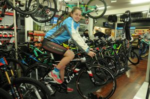 Pictured left, Bayley-Rose riding the $7,000 bike she will be taking to Mexico, supplied to her by Science Cycle, Lower Hutt.  Photo: Courtesy Hutt News
