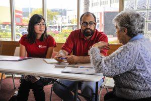 Caritas staff members give advice at the Benefit Impact.  Photo: Caritas