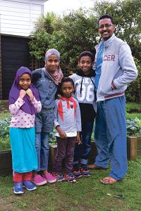 Standing proudly in front of the vegetable garden they have planted at the Island Bay house is Abdiasiis from Somalia with four of his children. From left: Satiro (6), Maandeeg (10), Fatiad (5), Mohamed (10) and Abdiasiis. Photo: Annette Scullion