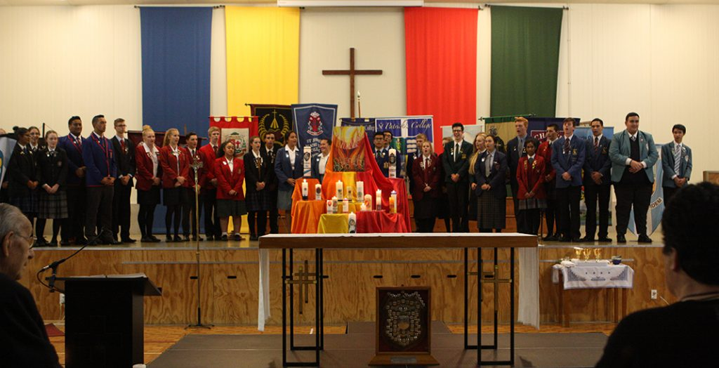 O'Shea teams assemble at the start of Sunday Mass presided by Bishop Charles Drennan.