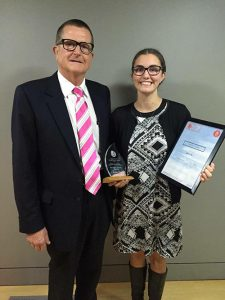 Pictured left, Jess receives Mayoral Award from Upper Hutt Mayor Wayne Guppy.