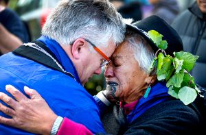 New Plymouth Mayor Andrew Judd is embraced by Parihaka elder Te Whero o te Rangi Bailey.