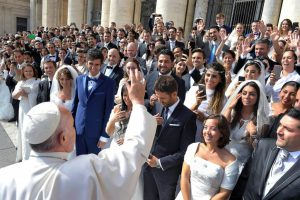 Pope Francis greets newly married couples during his general audience in St Peter's Square at the Vatican on 30 September 2015. Photo: Creative Commons/CNS.