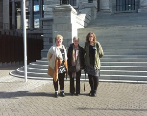 Outside parliament are (l–r) Teresa Homan, Lesley Hooper, and Lisa Beech.
