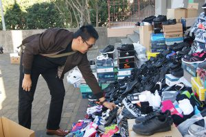 Ignatius Susilo from ICPE Mission at Mt Victoria's St Gerard's Monastery, donates a pair of shoes to the Mountain of Mercy.