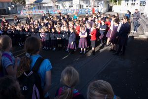 St Anthony's students at Seatoun welcome St Antonio's students, visiting from across the water, with a pōwhiri.