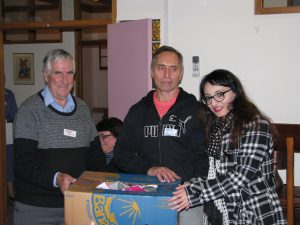 'Instruments of Mercy' in action, (l–r) Fr Phil Cody sm and Wawata Johnson present school materials on behalf of Ōtaki Print and Railway Bookshop to Tayyaba Khan, CEO of Changemakers Refugee Forum. Photo: Rowan Donoghue sm.