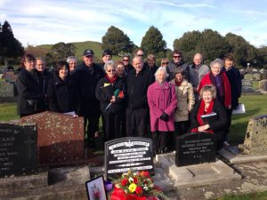 Family of James Lewis George Grant gather at his headstone where his ashes were laid to rest at his father's plot in Taranaki on July 9.  Supplied