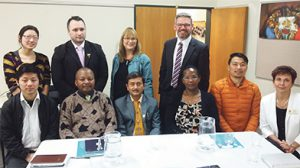 'We all have a migration story' – back (l-r): Cathy Bi (Caritas); Darroch Ball (NZ First MP); Denise Roche (Green MP); Iain Lees-Galloway (Labour MP). Front (l-r): Poe Zaw; Jean-Christophe Massimba; Indra Dulal; Antoinette Umugwaneza; Deven Rai; Sonja de Lange.