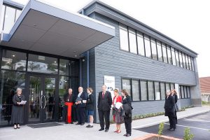 Outside the new administration and learning centre, Principal Mrs Mary Curran welcomes Cardinal John Dew and other guests.