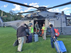 Evacuees boarding NZ Defence helicopter to fly out. Photo: Ray Byrne