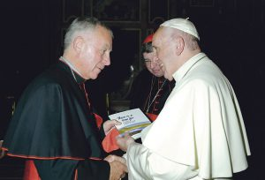 Cardinal John presents Pope Francis with the first copy of 'There's a Time For… a new book of family prayers being launched in Wellington in December.